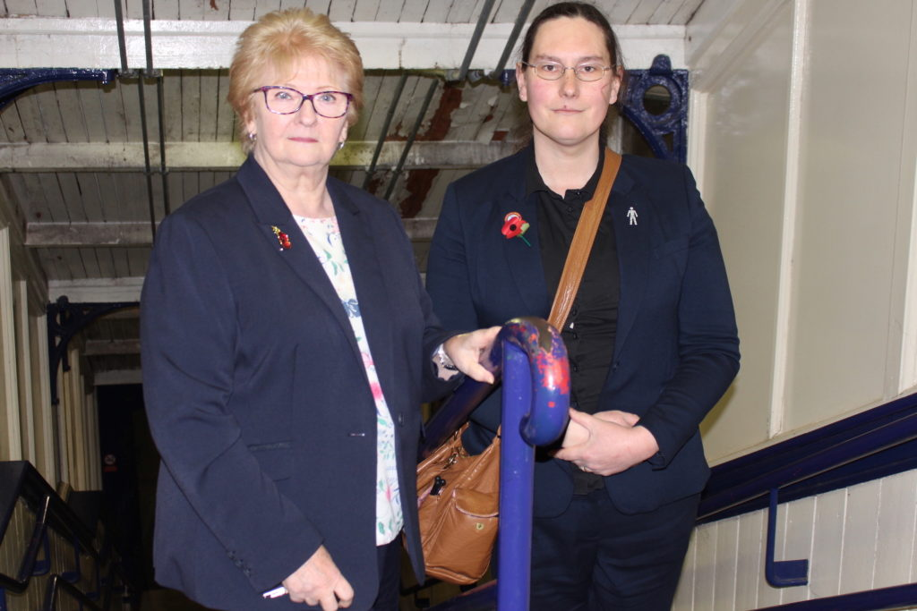 Cllrs Christine Wild and Zoë Kirk-Robinson stood on the stairs leading down to the platforms at Daisy Hill Station, November 2018